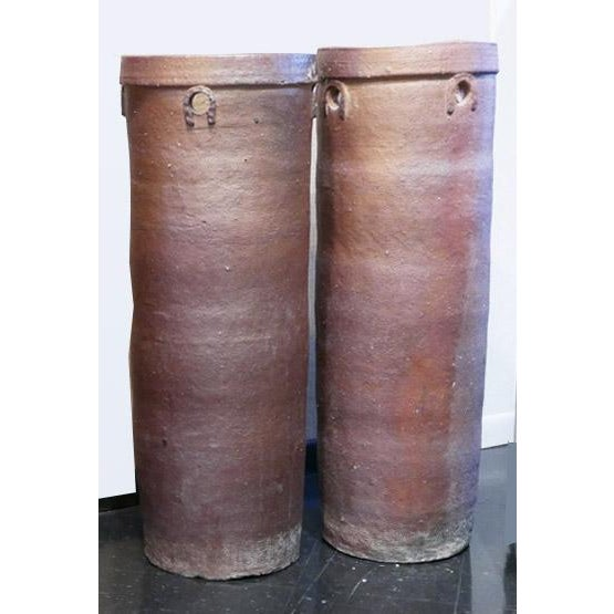 """This tall brown cylinder vessel is 39 1/4"""" tall and is very heavy. Because of the size, I believe it is layered pottery..."""