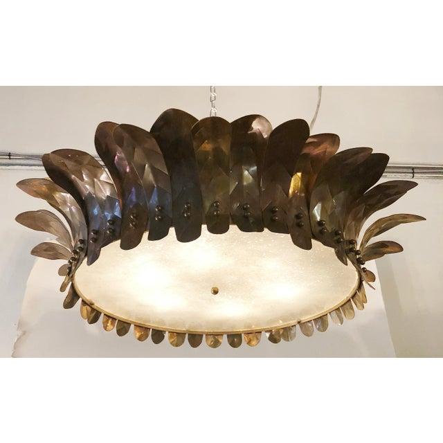 Limited edition Italian semi flush mounts with brass leaves and Murano glass diffuser hand blown in Graniglia technique to...