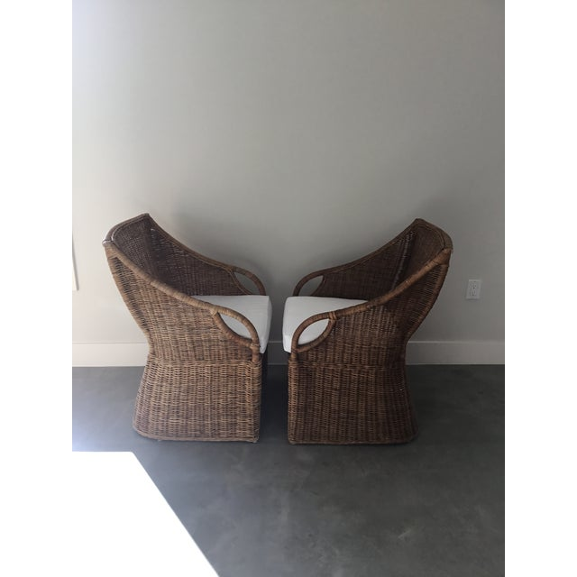 The airy rattan weave gives this chair a casual elegance that suits relaxed entertaining. Handcrafted with naturally...