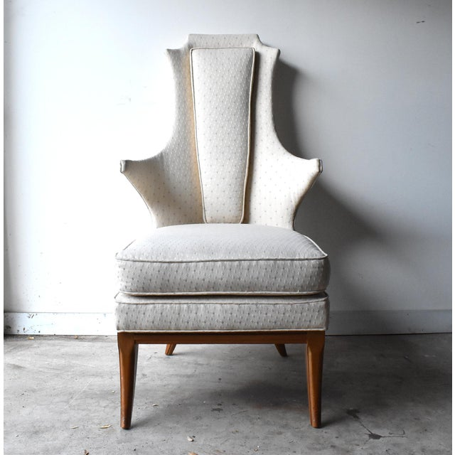 A vintage, c. 1950s mid-century modern, arm chair, with stylized clean lines and curves. Attached bottom and back...