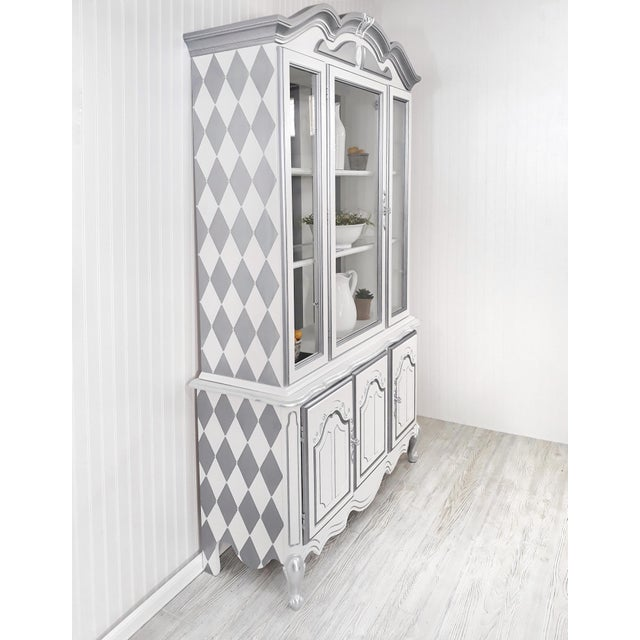 This one piece vintage hutch was completely reimagined in shades of soft whites and softly shimmering cool gray stripes....