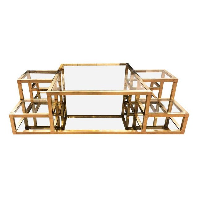 Multi-level Italian Mid-Century coffee table with brass frame, glass tops and mirrored glass inserts at the bottom....