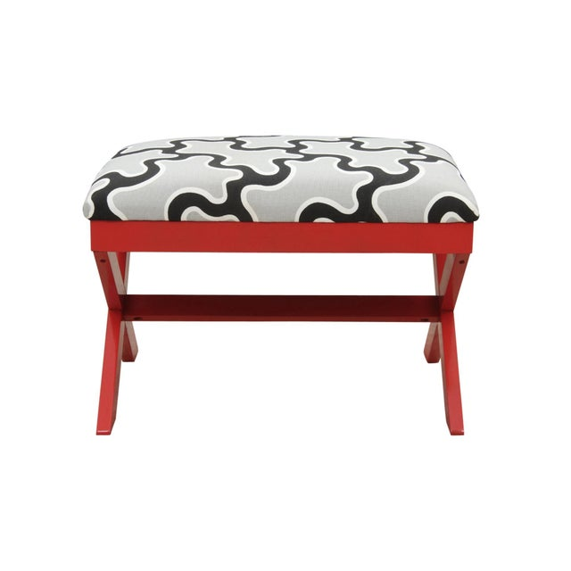 A curule bench with the seat newly upholstered in Kravet's Cumulus cotton fabric in Kohl from their Diane Von Furstenberg...