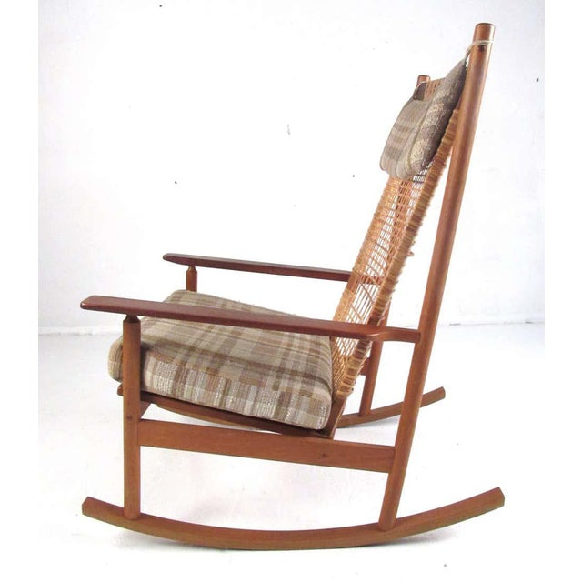 This beautiful Danish modern teak rocking chair was designed by Hans Olsen and produced by Juul Kristensen, circa 1963. It...
