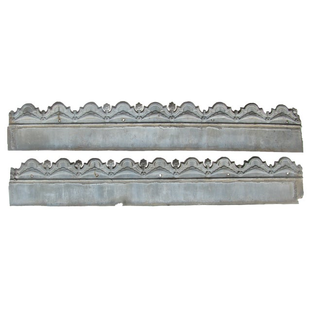 Pair of 19th C. French zinc architectural elements with elaborate surface detail and a scalloped edge , probably a fascia...