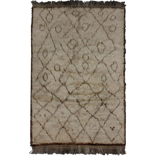 Pamper your feet with the highest quality natural wool shag rug. This rectangular area rug with it's beautiful brown &...