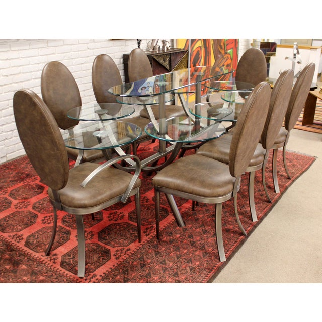 """For your consideration is a magnificent """"Circle of Life"""" dining set, including glass and steel table and set of eight..."""