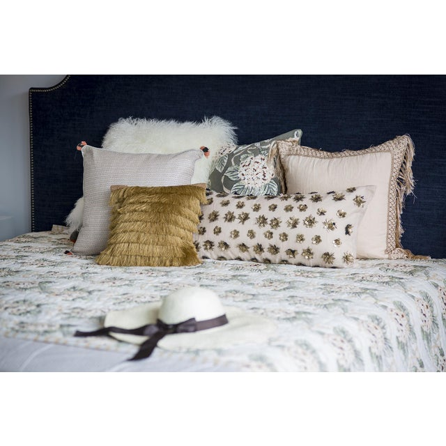 A fully-fashioned pillow, featuring fringe! The small accent pillow, highlights the multiple layers of soft golden dyed...
