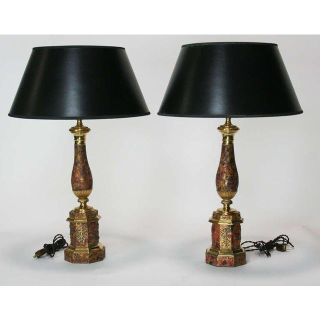 Lovely pair of lamps made from 19th Century French tole and gilt bronze oil lamps, with a faux marble paint finish. Shades...
