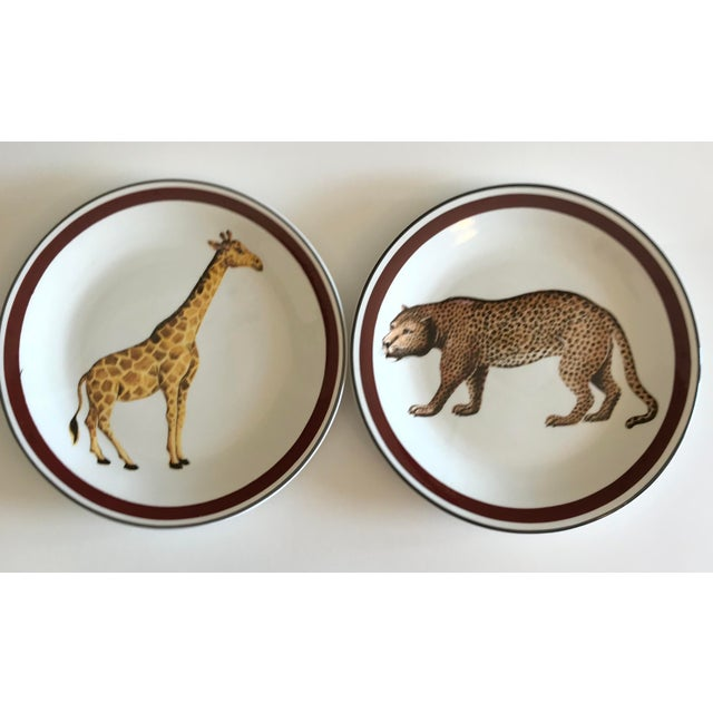 Set of two hand painted decorative/dinner plates made in Italy for Mottahedeh in the mid-century. Giraffe and leopard...