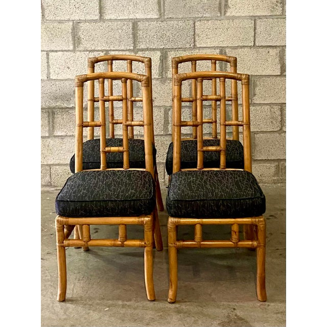 Beautiful set of bamboo dining chairs. Four chic chairs with a contemporary grid back design. Almost a MidCentury shape to...