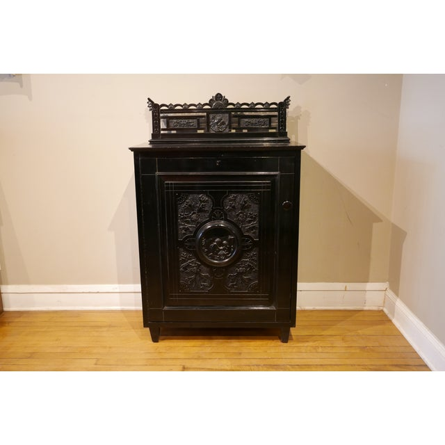 Antique Victorian ebonized music cabinet for Vinyl Records. Beautifully hand carved figures and florals in center medalion...