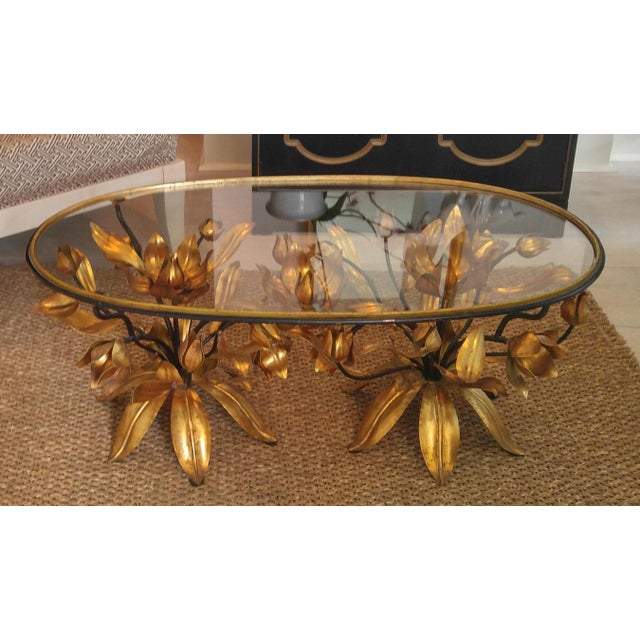 Fabulous, well kept, like new, Hollywood Recency coffee table. This table is stunning. The gold and the glass are...