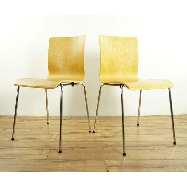 Raised on metal pin form legs. Brand is Room & Board. Made in the 2010s in the style of modern.