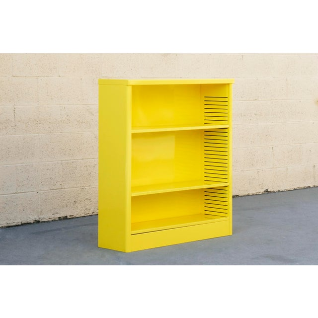 Neat 1960s tanker style steel bookcase freshly powder coated in high gloss Mellow Yellow (YL01). Originally used in the...