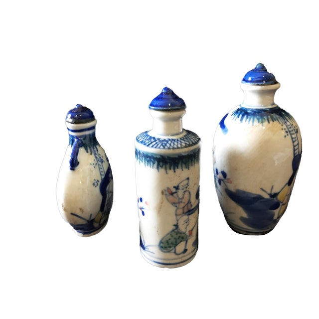 Superb set of three hand painted in different shape of blue and white snuff bottles depicting figures and flowers marked...