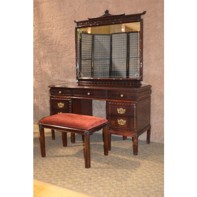 This is a vintage vanity and bench created with Asian inspirations. The vanity has seven drawers and maintains its...