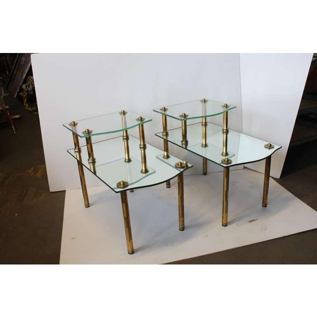 Pair of Mid Century solid brass base tables with mirrored tops. Would look great in a Hollywood regency style home.