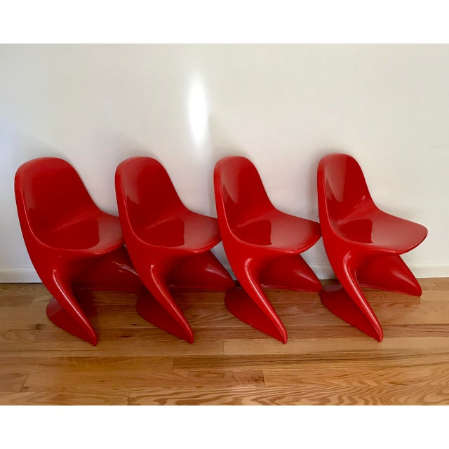 Set of 4 stackable Casalino plastic children seats in red colors. Made in the 1970s. Reasonable offer will be considered....