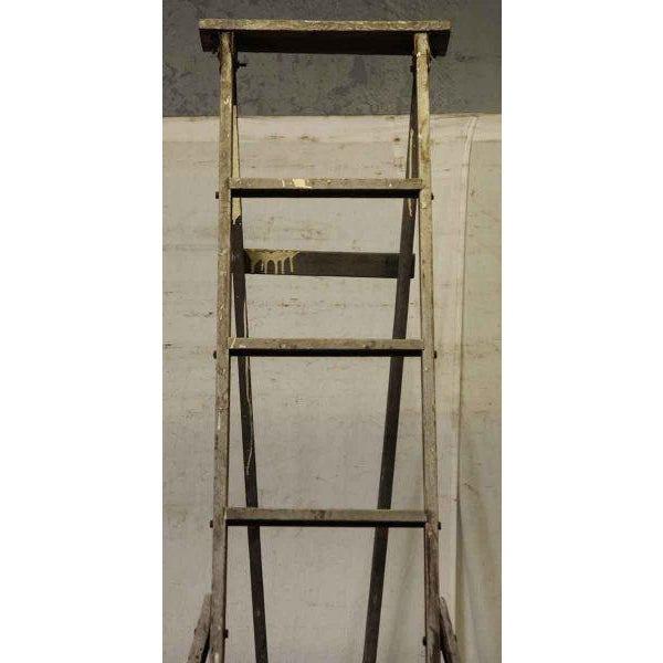 Wooden apple ladder with splattered paint.