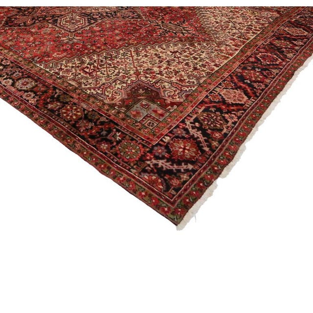 Impeccably woven from hand-knotted wool, this vintage Persian Heriz rug showcases Mid-Century Modern style and a beautiful...