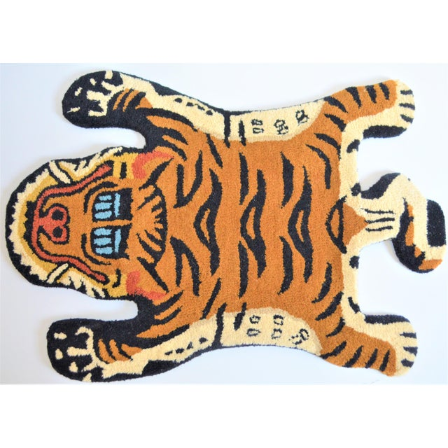 This is a whimsical rug in the shape of Tibetan Tiger. It is called a Persian hunting rug and they are often done with...