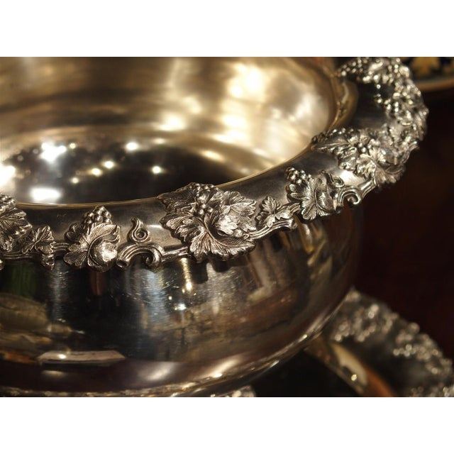 This magnificent silver plated punch bowl and tray have detailed motifs of various sized grape clusters with leaves around...