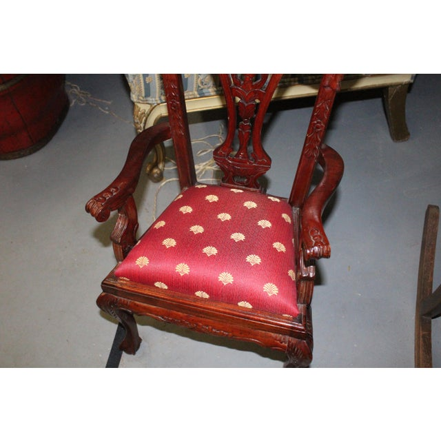 Children's mahogany Chippendale chair with red and gold upholstery. Perfect for a play room.