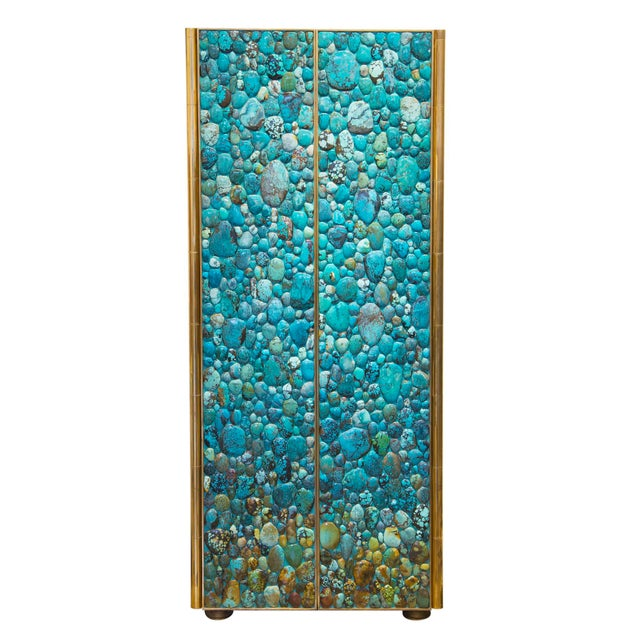 One of the most iconic pieces created by KAM TIN : a tall cabinet / bar cabinet made with real natural turquoise...