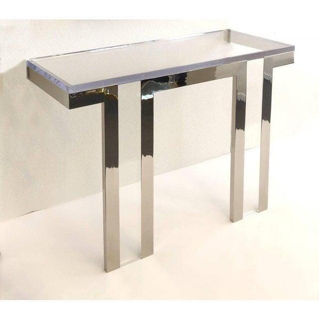 "A rare 1970s polish nickel and clear Lucite ""Box Line"" console table by renowned designer Charles Hollis Jones. The table..."
