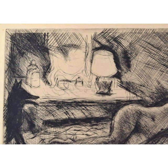 Henri Farge (French 1884-1970) etching on paper depicting a nude woman lying on a divan, cast in light from the boudoir...