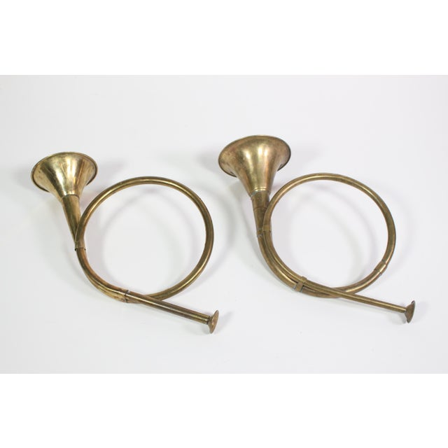 Set of two decorative brass french horns from the 1940's. Perfect holiday decorum to add to an arrangement or hang as...