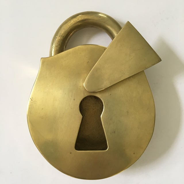 This is a lovely, rare, solid-brass piece from 1970 made by Virginia Metalcrafters in the shape of a large padlock with an...