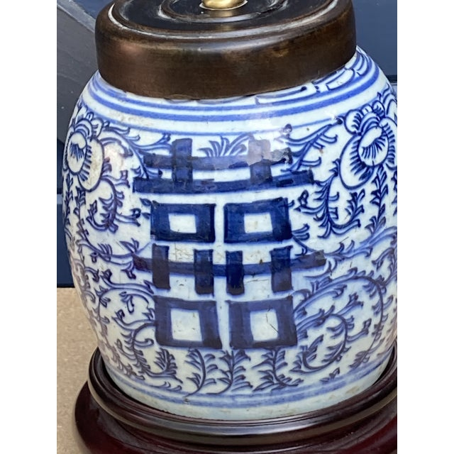 An early 20th century Chinese ginger jar later made into a table lamp, newly wired and ready to go, shade pictured is sold...