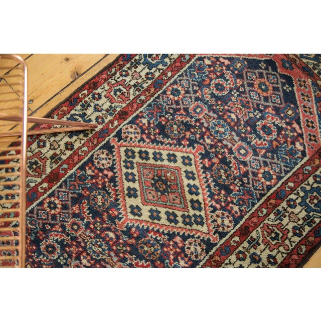 :: Finely woven Borchalou rug with horizontally elongated diamond shaped center medallion atop a covered field in Herati...