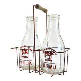 Two Vintage Milk Bottles and Metal Carrier With Wood Handle For Sale