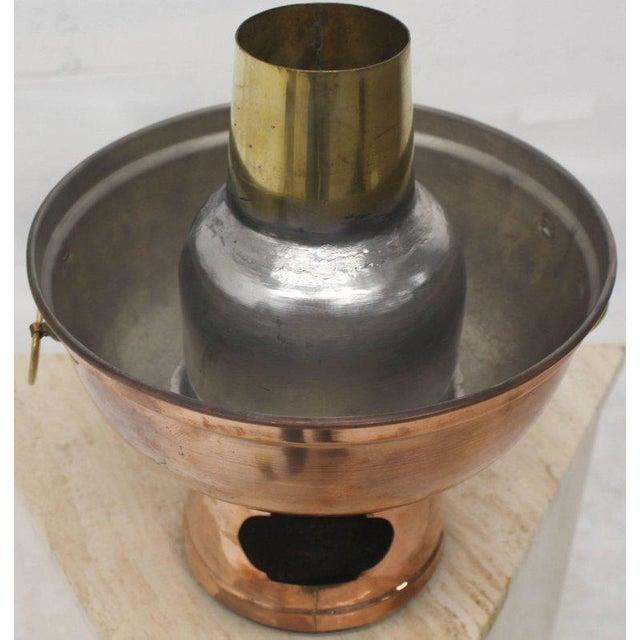 Nice metal craftsmanship fuel pellets food warmer. It works with hook pipe type coal or fuels pellets.