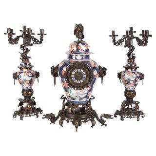 French Japonisme Parcel-Gilt Patinated Bronze Imari Porcelain Clock Garniture For Sale