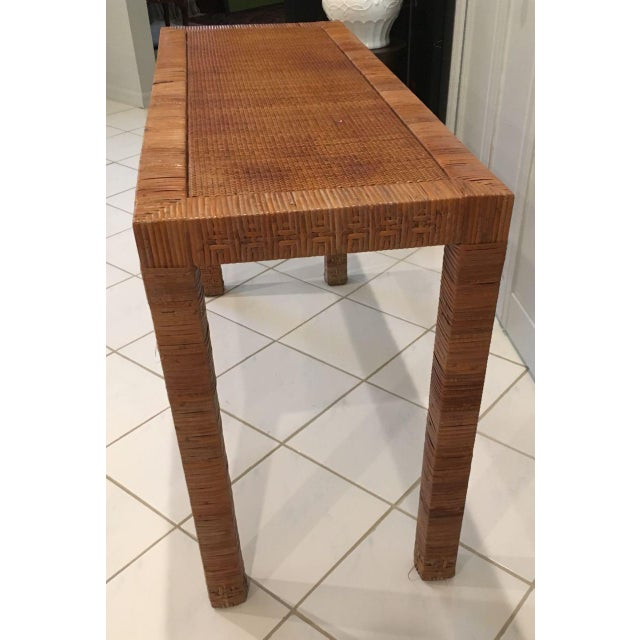 Cane wrapped console table in the style of Billy Baldwin. Parson's type table with legs and apron of equal width. The...