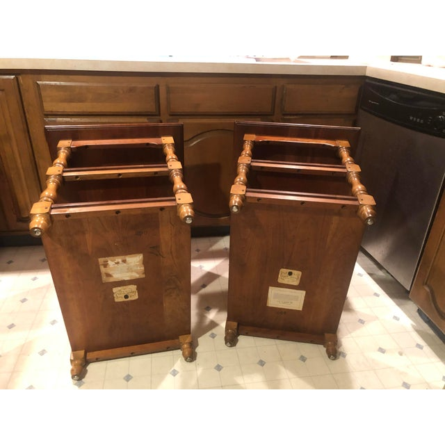 They are solid Cherry construction and have turned leaves with two shelves. They both have the paper labels and burn marks.
