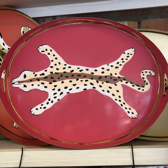 This is an oval tole tray by Dana Gibson and is a new in perfect condition. It is also hand-painted.