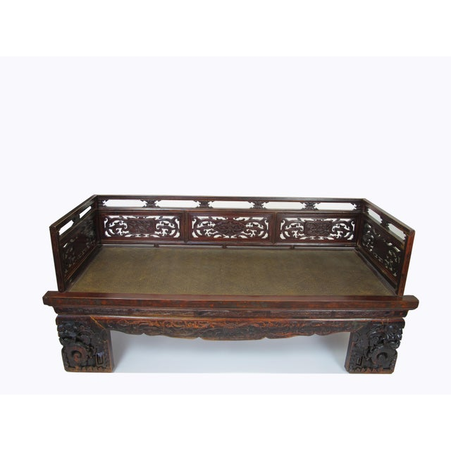With its beautifully hand carved railing, front apron and legs, this over a century old antique Chinese Luohan bed makes a...