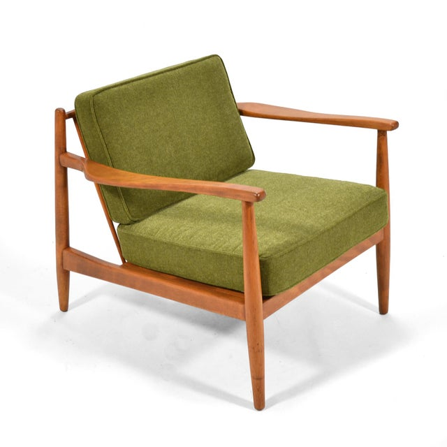 A lovely Scandinavian design by Alf Svensson for Dux, this birch lounge chair has been fully reupholstered and has new...