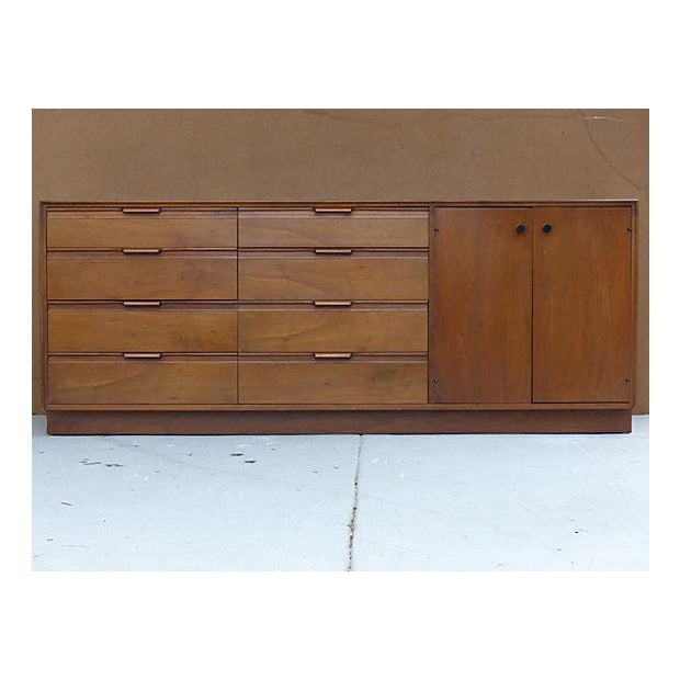 Vintage credenza by American of Martinsville. Features eight drawers on the left with dovetail pulls, and four white-...