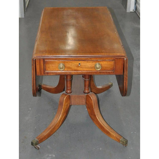 Superb 19th Century Mahogany English Regency Breakfast Table c.1815 Drop leaf table on a pedestal base w/ one end drawer,...