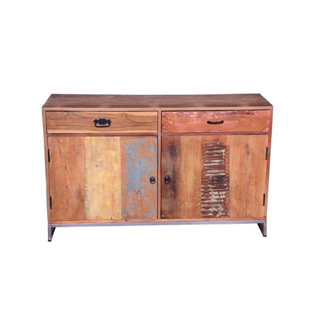 This two drawer sideboard features a recycled wood with natural finish and square legs which add a rustic touch to the...