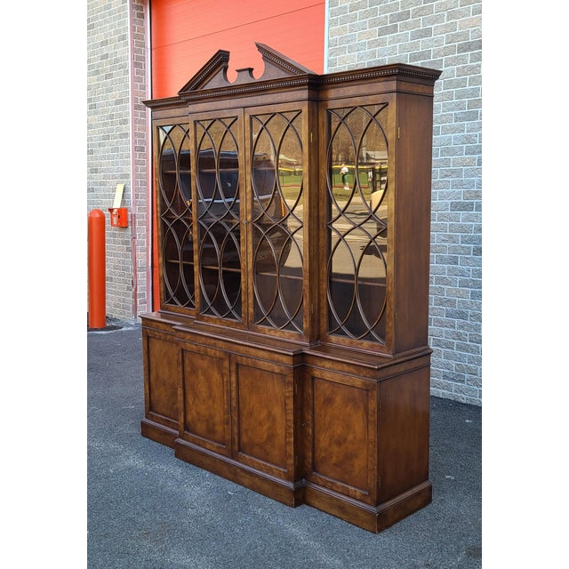 This is a very nice high quality mahogany Regency style dining room breakfront china cabinet made by Old Colony Furniture,...