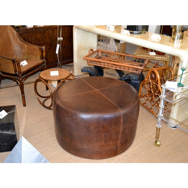 Ottoman in luxurious antique leather. Sown in quarters on the seating surface. We use only the very best quality leather....