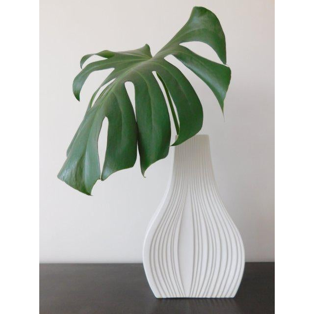 Large modernist white bisque porcelain vase from Naaman Israel in an onion shape, ca. 1980s. The vase features a shiny...