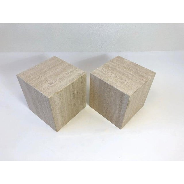 A beautiful pair of polish Italian travertine side tables from the 1970s. The tables have been newly professionally...